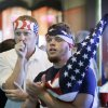 Aaron Todd, right, and Zach Crabtree, both of Knoxville, Iowa, react as they watch the World Cup Soccer match between the United States and Germany at a local bar, Thursday, June 26, 2014, in West Des Moines, Iowa. Thousands of eager Americans set work aside on Thursday _ with or without their bosses' OK _ to watch the key World Cup match. Todd and Crabtree said they took the day off to watch the match. (AP Photo/Charlie Neibergall)