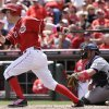 Photo - Cincinnati Reds' Todd Frazier (21) hits a solo home run off Colorado Rockies starting pitcher Juan Nicasio in the fourth inning of a baseball game, Sunday, May 11, 2014, in Cincinnati. Michael McKenry catches at right. (AP Photo/Al Behrman)