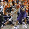Oklahoma State\'s Cezar Guerrero (1) goes for the ball beside Kansas State\'s Shane Southwell (1) during an NCAA college basketball game between the Oklahoma State University Cowboys (OSU) and the Kansas State University Wildcats (KSU) at Gallagher-Iba Arena in Stillwater, Okla., Saturday, Jan. 21, 2012. Photo by Bryan Terry, The Oklahoman