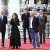 Shania Twain, second left, speaks after making her official arrival on horseback at Caesars Palace in Las Vegas on Wednesday, Nov. 14, 2012. Twain is set to begin a two-year residency at the Colosseum with her show