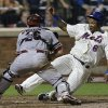 Photo - New York Mets' Marlon Byrd, right, slides safely home past Arizona Diamondbacks catcher Miguel Montero to tie the game during the ninth inning of the baseball game at Citi Field, Monday, July 1, 2013, in New York. (AP Photo/Seth Wenig)
