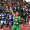 Photo - Oregon's Devon Allen celebrates after winning the men's 110-meter hurdles at the NCAA track and field championships Saturday, June 14, 2014, in Eugene, Ore. (AP Photo/Rick Bowmer)