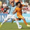Real Madrid\'s Marcelo from Brazil, right, vies for the ball with Celta\'s Fabian Orellana from Chile during a Spanish La Liga soccer match at the Balaidos stadium in Vigo, Spain, Sunday, May 11, 2014. (AP Photo/Lalo R. Villar)