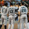 Seattle Mariners\' Nick Franklin, third from left, receives high-fives from teammates Raul Ibanez (28), Dustin Ackley (13) and Brad Miller (5) after hitting a grand slam against the Houston Astros in the second inning of a baseball game on Sunday, July 21, 2013, in Houston. (AP Photo/Bob Levey)