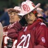 UNIVERSITY OF OKLAHOMA VS KANSAS STATE UNIVERSITY BIG 12 CHAMPIONSHIP COLLEGE FOOTBALL AT ARROWHEAD STADIUM IN KANSAS CITY, MISSOURI, DECEMBER 6, 2003. FANS: An OU Sooner fan stands dejected during OU\'s loss to KSU. Staff photo by Ty Russell