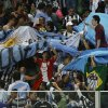 Photo - Fans hold a large Argentine flag and sing during a training session of the Argentine national soccer team at Independencia Stadium in Belo Horizonte, Brazil, Wednesday, June 11, 2014. Argentina will play in group F of the Brazil 2014 soccer World Cup. (AP Photo/Bruno Magalhaes)