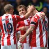 Photo - Stoke City's Marko Arnautovic, right, celebrates with teammates Marc Muniesa, center, and Jonathan Walters after forcing West Bromwich Albion's Gareth McAuley into scoring an own goal during, their English Premier League soccer match at The Hawthorns, West Bromwich, England, Sunday, May 11, 2014. (AP Photo/Joe Giddens, PA Wire)    UNITED KINGDOM OUT   -   NO SALES   -   NO ARCHIVES