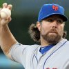 R.A. Dickey, the New York Mets\' knuckleball specailist, pitches to the Los Angeles Dodgers in the first inning of a baseball game at Dodger Stadium in Los Angeles Friday, June 29, 2012. Dickey allowed three hits over eight innings to become the major leagues\' first 12-game winner, Daniel Murphy drove in five runs and the New York Mets sent the Los Angeles Dodgers to their season-worst sixth straight loss with an 9-0 victory Saturday night.(AP Photo/Reed Saxon) ORG XMIT: LAD111