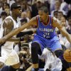 Oklahoma City\'s Kevin Durant (35) works against San Antonio\'s Stephen Jackson (3) during Game 5 of the Western Conference Finals between the Oklahoma City Thunder and the San Antonio Spurs in the NBA basketball playoffs at the AT&T Center in San Antonio, Monday, June 4, 2012. The Thunder won, 108-103. Photo by Nate Billings, The Oklahoman