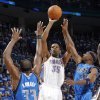 Oklahoma City\'s Kevin Durant (35) shoots the ball over Brendan Haywood (33) of Dallas and Jason Terry (31) of Dallas during game 3 of the Western Conference Finals of the NBA basketball playoffs between the Dallas Mavericks and the Oklahoma City Thunder at the OKC Arena in downtown Oklahoma City, Saturday, May 21, 2011. Photo by Chris Landsberger, The Oklahoman