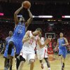 Oklahoma City\'s Kevin Durant (35) goes to the basket beside Houston\'s Francisco Garcia (32) during Game 6 in the first round of the NBA playoffs between the Oklahoma City Thunder and the Houston Rockets at the Toyota Center in Houston, Texas, Friday, May 3, 2013. Oklahoma City won 103-94. Photo by Bryan Terry, The Oklahoman