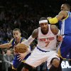 Photo - Golden State Warriors' Stephen Curry, left, knocks the ball away from New York Knicks' Carmelo Anthony (7) as Warriors' Andre Iguodala (9) defends during the first half of an NBA basketball game on Friday, Feb. 28, 2014, in New York. (AP Photo/Frank Franklin II)