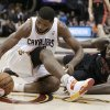 Cleveland Cavaliers\' Tristan Thompson, left, and Toronto Raptors\' Amir Johnson scramble for a loose ball during the fourth quarter of an NBA basketball game Wednesday, Feb. 27, 2013, in Cleveland. The Cavaliers won 103-92. (AP Photo/Tony Dejak)