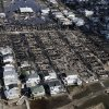 This aerial photo shows the Breezy Point neighborhood, in New York, Wednesday, Oct. 31, 2012, where more than 50 homes were burned to the ground Monday night as a result of superstorm Sandy. Sandy, the storm that made landfall Monday, caused multiple fatalities, halted mass transit and cut power to more than 6 million homes and businesses. (AP Photo/Mark Lennihan) ORG XMIT: NYML109