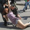 FILE - In this Saturday, May 28, 2011 file photo Russian police officers detain a gay rights activist during an attempt to hold a gay pride parade in Moscow, Russia. A controversial bill banning