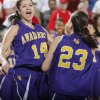 FORT GIBSON / CLASS 4A GIRLS HIGH SCHOOL BASKETBALL / STATE TOURNAMENT / CELEBRATION: Anadarko\'s Ashley Beatty (14) and Lakota Beatty (23) celebrate the win over Ft. Gibson during the 4A girls State Basketball Championship game between Ft. Gibson High School and Anadarko High School at State Fair Arena on Saturday, March 10, 2012 in Oklahoma City, Okla. Photo by Chris Landsberger, The Oklahoman