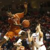 Photo - Texas' Damarcus Croaker throws a pass over Texas Tech's Dusty Hannahs (2) during their NCAA college basketball game in Lubbock, Texas, Saturday, Mar, 8, 2014. (AP Photo/Lubbock Avalanche-Journal, Zach Long) ALL LOCAL TV OUT