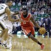 Photo - Houston Rockets' James Harden (13) drives around Utah Jazz's Rudy Gobert (27), of France, in the first quarter during an NBA basketball game Saturday, Nov. 2, 2013, in Salt Lake City.  (AP Photo/Rick Bowmer)