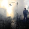 Firefighters try to extinguish the fire in a burning house where 3 boys lost their lives in a fire, burning in the village of Mesoropi in northern Greece, Saturday, Dec. 8, 2012. Giorgos Tsimirikas, his wife and his 6 youngest children were spending the weekend at his parents\' house when the fire broke out early Saturday, caused by a wooden stove. The house had central heating but the owners used a stove because of the steep rise in the price of heating oil as a result of the Greek government\'s recent fiscal measures. (AP Photo/Haris Iordanidis)