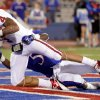 Oklahoma\'s Kenny Stills (4) catches a touchdown pass beside Kansas\' Greg Brown (5) during the college football game between the University of Oklahoma Sooners (OU) and the University of Kansas Jayhawks (KU) at Memorial Stadium in Lawrence, Kansas, Saturday, Oct. 15, 2011. Photo by Bryan Terry, The Oklahoman