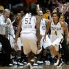 Texas A&M\'s Sydney Carter (4) runs past Texas A&M coach Gary Blair and the bench as they celebrate a basket during the women\'s college basketball Big 12 Championship tournament game between the University of Oklahoma and Texas A&M in Kansas City, Mo., Friday, March 11, 2011. Photo by Bryan Terry, The Oklahoman