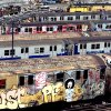 """Photo - FILE - This undated file photo provided by the Museum of the City of New York shows graffiti-covered subway cars parked in a  New York City rail yard. Graffiti is the subject of an exhibition opening on Feb. 4, 2014 and running through Aug. 24 at the Museum of the City of New York. """"City as Canvas: Graffiti Art from the Martin Wong Collection"""" is the first exhibition of the collection of graffiti art amassed by artist and pioneering collector Martin Wong in the 1970s and '80s. (AP Photo/Museum of the City of New York, Camilo Jose Vergara, File)"""