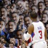 Photo - Los Angeles Clippers guard Chris Paul looks on as fans hold up pictures of him during the first half of their NBA basketball game against the Dallas Mavericks, Wednesday, Jan. 9, 2013, in Los Angeles. (AP Photo/Mark J. Terrill)