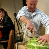 Representative Joe Dorman, of Rush Springs, cuts watermelons to serve to visitors and employees at the state Capitol in Oklahoma City on Wednesday, July 29, 2009. By John Clanton, The Oklahoman