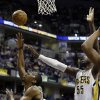 Boston Celtics\' Jordan Crawford (27) shoots against Indiana Pacers\' Roy Hibbert (55) during the first half of an NBA basketball game Wednesday, March 6, 2013, in Indianapolis. (AP Photo/Darron Cummings)