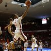 Oklahoma\'s Isaiah Cousins (11) goes past Texas Tech\'s Dusty Hannahs (2) during an NCAA college basketball game between the University of Oklahoma and Texas Tech University at Lloyd Noble Center in Norman, Okla., Wednesday, Jan. 16, 2013. Photo by Bryan Terry, The Oklahoman