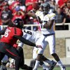 West Virginia\'s Geno Smith throws under pressure from Texas Tech\'s Dennell Wesley during an NCAA college football game in Lubbock, Texas, Saturday, Oct. 13, 2012. (AP Photo/Lubbock Avalanche-Journal, Stephen Spillman) LOCAL TV OUT