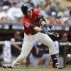 Photo - United States' Justin O'Conner drives in a run during the third inning of the All-Star Futures baseball game against the World team, Sunday, July 13, 2014, in Minneapolis. (AP Photo/Jeff Roberson)
