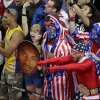 Fans cheer for the United States men\'s basketball team during the gold medal basketball game against Spain at the 2012 Summer Olympics, Sunday, Aug. 12, 2012, in London. (AP Photo/Victor Caivano)