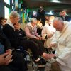 "Photo - Pope Francis washes the foot of a woman at the Don Gnocchi Foundation Center in Rome on Thursday.   The pontiff washed the feet of 12 elderly and disabled people — women and non-Catholics among them — in a pre-Easter ritual designed to show his willingness to serve like a ""slave."" AP Photo/L'Osservatore Romano   -"
