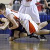 Weleetka\'s Caleb Smith and Cheyenne-Reydon\'s Braygan Lippenscott fight for a loose ball the Class A boy\'s semi final game between Cheyenne-Reydon and Weleetka at the State Fair Arena in Oklahoma City, Friday, March 2, 2012. Photo by Sarah Phipps, The Oklahoman