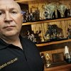 Edmond Police Department\'s Sgt. Tony Fike poses for a photo next to his mantle of marksmanship trophies at his home on Thursday, Feb. 7, 2008, in Edmond, Okla. BY CHRIS LANDSBERGER, THE OKLAHOMAN