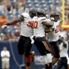 Oklahoma State\'s Calvin Barnett (99), Tyler Johnson (40) and Lyndell Johnson (27) celebrate a play during first half of the AdvoCare Texas Kickoff college football game between the Oklahoma State University Cowboys (OSU) and the Mississippi State University Bulldogs (MSU) at Reliant Stadium in Houston, Saturday, Aug. 31, 2013. Photo by Sarah Phipps, The Oklahoman