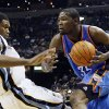 Photo - Oklahoma City Thunder forward Kevin Durant (35) goes to the basket against Memphis Grizzlies forward Rudy Gay in the first half of an NBA basketball game Wednesday, Dec. 28, 2011, in Memphis, Tenn. (AP Photo/Lance Murphey) ORG XMIT: TNLM104