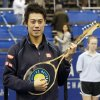 Kei Nishikori, of Japan, holds the winner\'s trophy after defeating Ivo Karlovic, of Croatia, 6-4, 7-6 (0) in the singles final at the U.S. National Indoor Tennis Championships, Sunday, Feb. 16, 2014, in Memphis, Tenn. The trophy is shaped like a guitar. (AP Photo/Rogelio V. Solis)