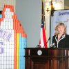 Gov. Mary Fallin announces Tuesday that enough food and money have been raised to provide about 1.6 million meals for Oklahomans. She is standing next to an Oklahoma City Thunder-based sculpture made by students from Bishop McGuinnes High School, who donated more than 5,000 pounds of food items. PHOTO BY MICHAEL MCNUTT, THE OKLAHOMAN