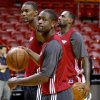 Photo - Miami's Dwyane Wade, foreground, Chris Bosh, left, and LeBron James stand on the court during a practice before Game 4 of the NBA Finals between the Oklahoma City Thunder and the Miami Heat at American Airlines Arena, Monday, June 18, 2012. Photo by Bryan Terry, The Oklahoman