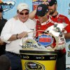 Kevin Harvick, right, hugs team owner Richard Childress, left, in victory lane after winning the AdvoCare 500 NASCAR Sprint Cup Series auto race at Phoenix International Raceway, Sunday, Nov. 10, 2013, in Avondale, Ariz. (AP Photo/Ralph Freso)