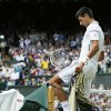 Novak Djokovic of Serbia knocks over his chair at a change of ends as he plays against Roger Federer of Switzerland during their men\'s singles final match at the All England Lawn Tennis Championships in Wimbledon, London, Sunday, July 6, 2014. (AP Photo/Sang Tan, Pool)