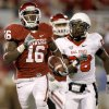 Oklahoma\'s Jaz Reynolds (16) runs past Ball State\'s Andre Dawson (28) after a reception during the college football game between the University of Oklahoma Sooners (OU) and the Ball State Cardinals at Gaylord Family-Memorial Stadium on Saturday, Oct. 01, 2011, in Norman, Okla. Oklahoma won 62-6. Photo by Bryan Terry, The Oklahoman