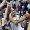 Connecticut\'s Bria Hartley, right, drives past Marquette\'s Brooklyn Pumroy during the first half of an NCAA college basketball game in Storrs, Conn., Tuesday, Feb. 5, 2013. (AP Photo/Fred Beckham)