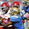 UCLA defensive back Brandon Sermons, center, stops Utah wide receiver Luke Matthews, left, short of a first down after a one-yard catch during the second half of their NCAA college football game, Saturday, Oct. 13, 2012, in Pasadena, Calif. UCLA won 21-14. (AP Photo/Alex Gallardo)
