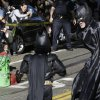 """Miles Scott, dressed as Batkid, center, walks with Batman to save a damsel in distress on the Cable Car line in San Francisco, Friday, Nov. 15, 2013. San Francisco turned into Gotham City on Friday, as city officials helped fulfill Scott\'s wish to be """"Batkid.""""Â Scott, a leukemia patient from Tulelake in far Northern California, was called into service on Friday morning by San Francisco Police Chief Greg Suhr to help fight crime, The Greater Bay Area Make-A-Wish Foundation says. (AP Photo/Jeff Chiu)"""