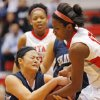 Micaela Yu (25) of Shawnee and Toni Cheadle (10) of Carl Albert fight for the ball during a girls high school basketball game between Shawnee and Carl Albert at Carl Albert High School in Midwest City, Okla., Friday, Feb. 10, 2012. Photo by Nate Billings, The Oklahoman