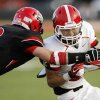 Mustang\'s Steven Fruit (9) tackles Hunter Meyn (33) of Yukon during a high school football game between Yukon and Mustang at Mustang High School in Mustang, Okla., Friday, Sept. 2, 2011. Photo by Nate Billings, The Oklahoman