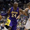 Los Angeles Lakers\' Kobe Bryant, left, drives past Minnesota Timberwolves\' Andrei Kirilenko of Russia in the second half of an NBA basketball game Wednesday, March 27, 2013 in Minneapolis. Bryant led the Lakers with 31 points in their 120-117 win. (AP Photo/Jim Mone)